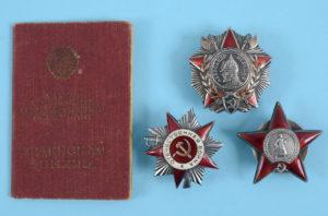 a group of medal s awarded to Platoon Commander Vladimir Venidiktovich Shkil