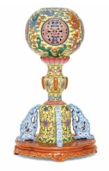 An imperial and very rare yellow-ground famille rose 'Nine Dragons' hat stand