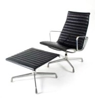A chair and footstool designed by Charles & Ray Eames for Herman Miller