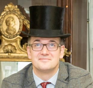 Charles Hanson wearing William Moorcroft's top hat