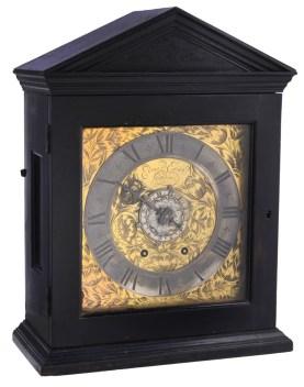 An important early ebony spring pendulum timepiece with alarm, Edward East, London, circa 1660
