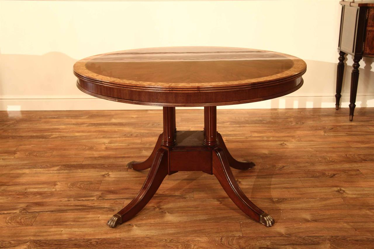 Small 48 Inch Round Mahogany Pedestal Dining Table With Leaf