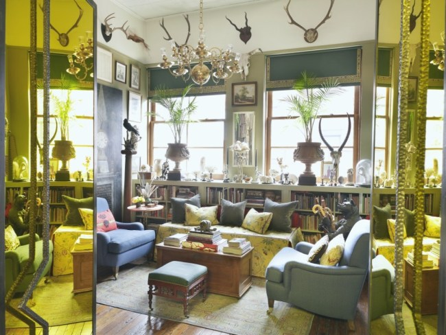 The Soho loft Jayne shares with his husband, Richmond Ellis, a food stylist and historian, is a laboratory for design ideas. Yellow mirrored doors open into a contemporary version of a connoisseur's cabinet room filled with specimens and objets d'art. Photo Don Freeman.