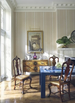 A modern Parsons-style dining table amid a collection of antique furniture creates a contemporary design contrast. Photo Pieter Estersohn.