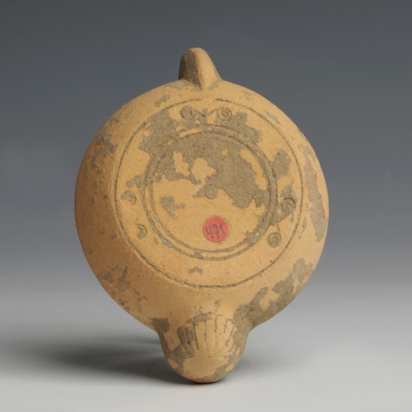 A Roman Terracotta Oil Lamp with a Bestiarius