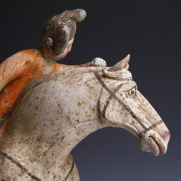 A Pair of Chinese Painted Terracotta Female Polo Players with Horses