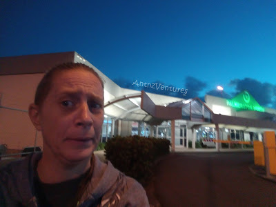A selfie with Antnz looking confused to the left of picture with Palmerston North Airport in background to the right.
