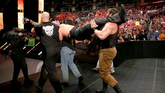 The Undertaker carried off by the Wyatt Family.