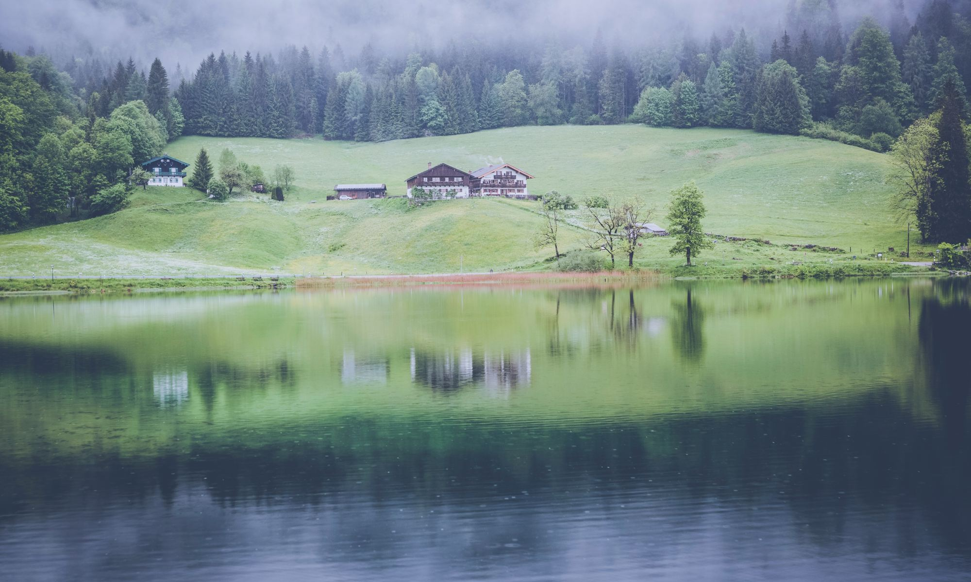 Photo of a lodge on a green field by a lake. Anton Jarrod describes how to organise a spiritual health check-up