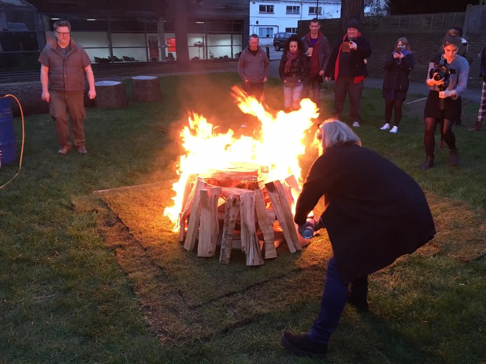 Photo of the fire being lit to create the hot coals for a fire walk