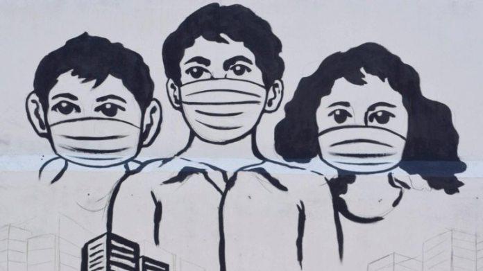 कोविद -19 के बारे में जागरूकता फैलाने के लिए गुवाहाटी में एक दीवार भित्ति