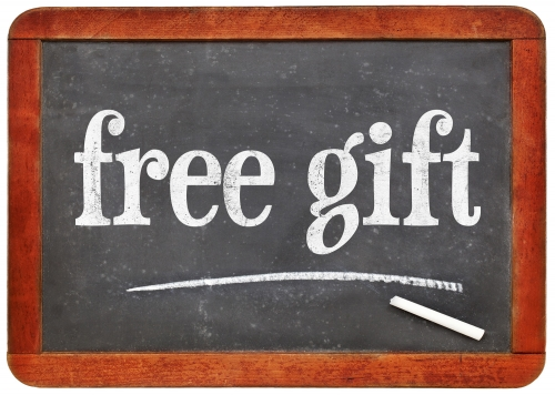 free gift - marketing concept - white chalk text on a vintage slate blackboard
