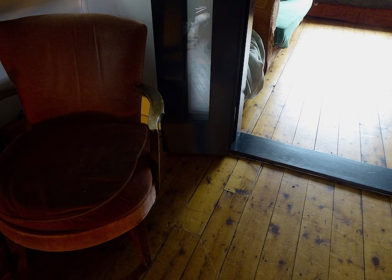 sanded floorboards and upcycled chair