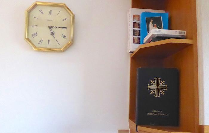 clock and prayer books