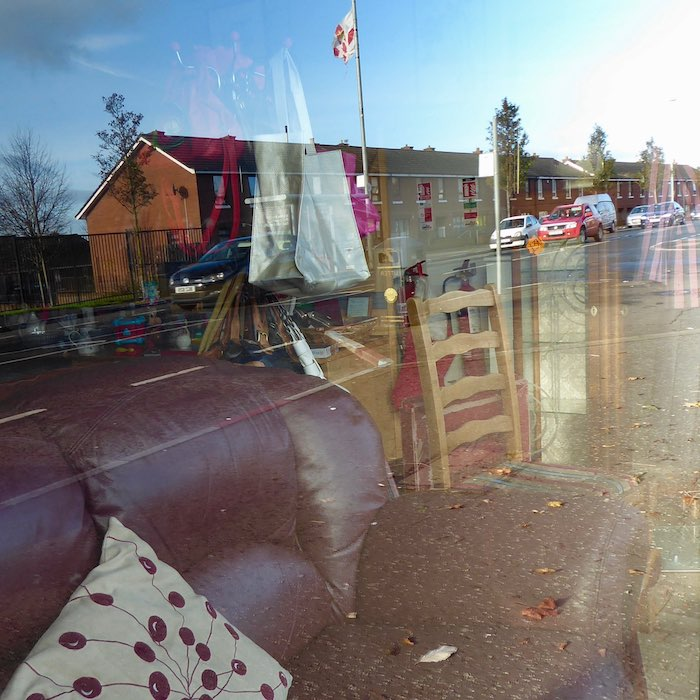charity shop window reflections