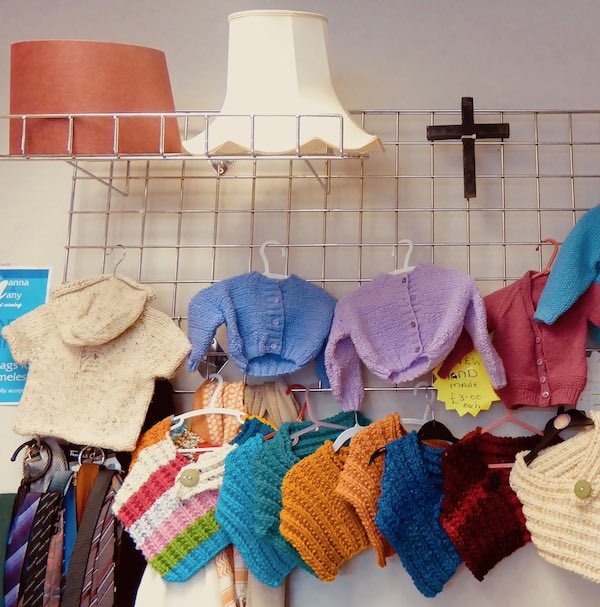 baby clothes, charity shop, display