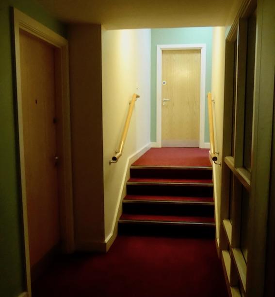corridor with door and steps