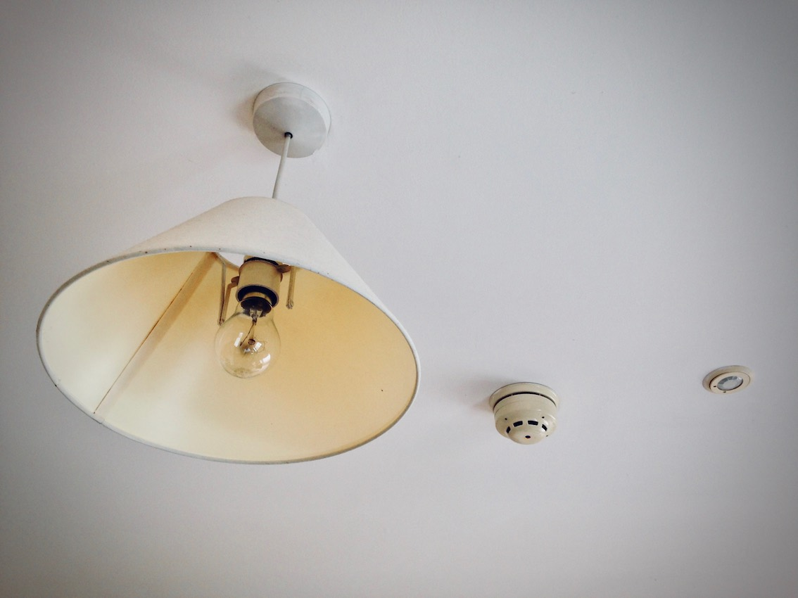 ceiling in care home room with lampshade and sprinklers