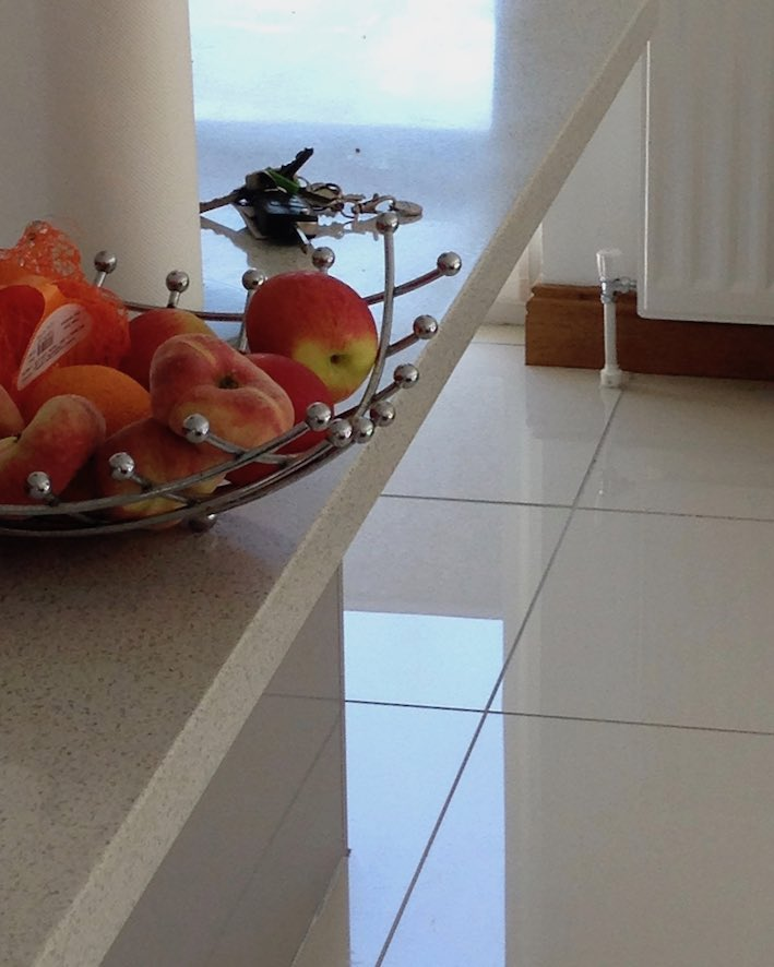 peaches on counter with reflections