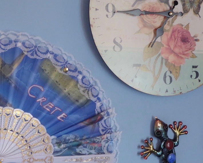decorative fan and clock on wall