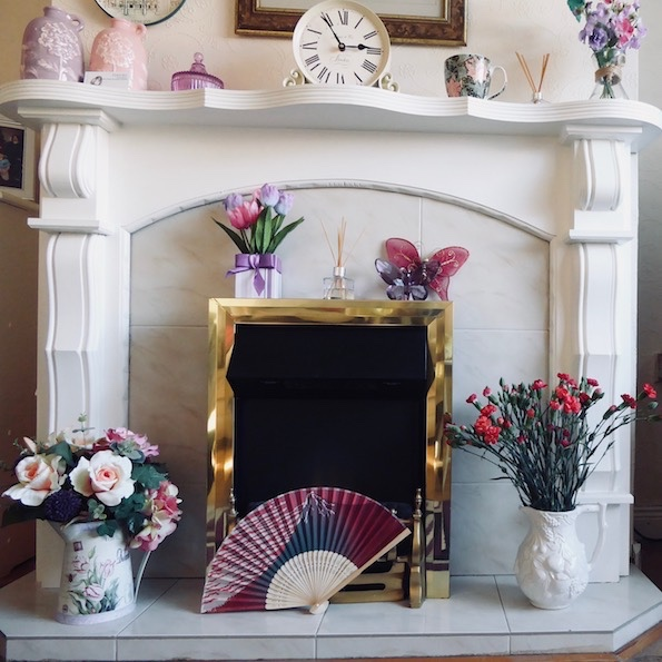 white fireplace and flowers