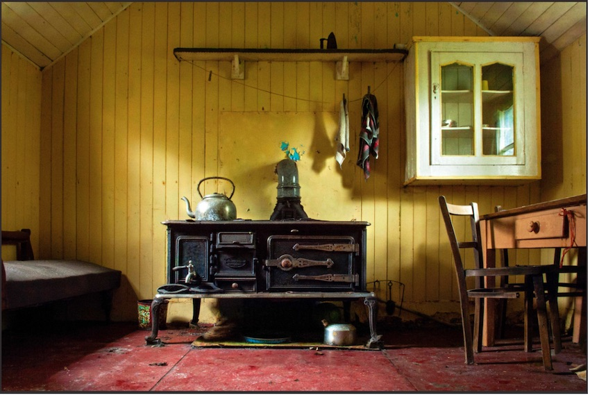 yellow room with old iron stove