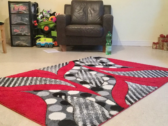 re and black rug with black chair