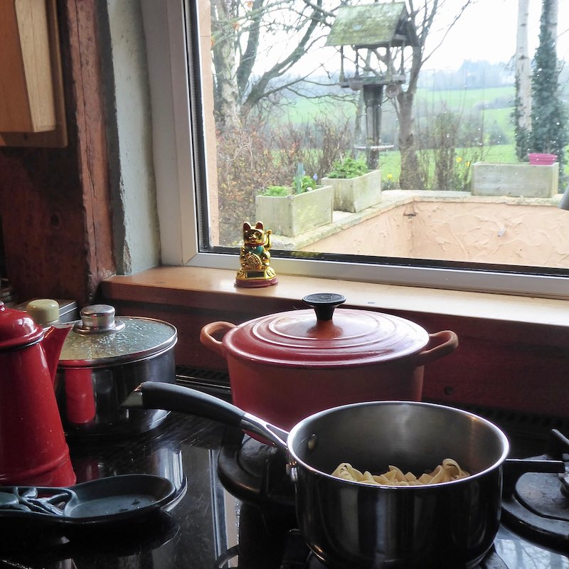 pots on hob beside window - country view