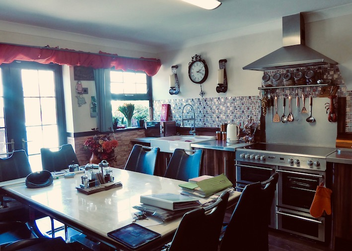 kitchen with cooker and large table
