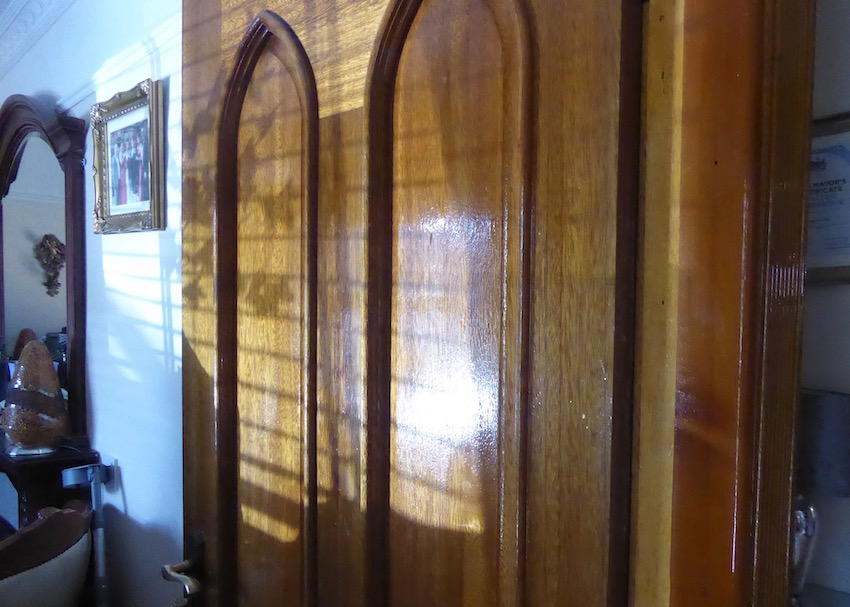 wooden interior door in sunlight