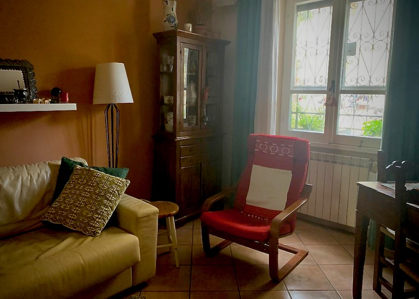 family home in Rome with sofa, window and table