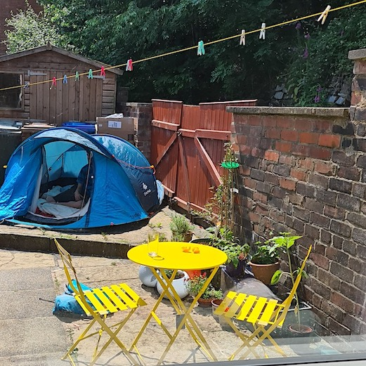 garden with tent and yellow table