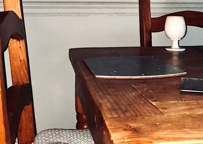 edge of dining table and chair