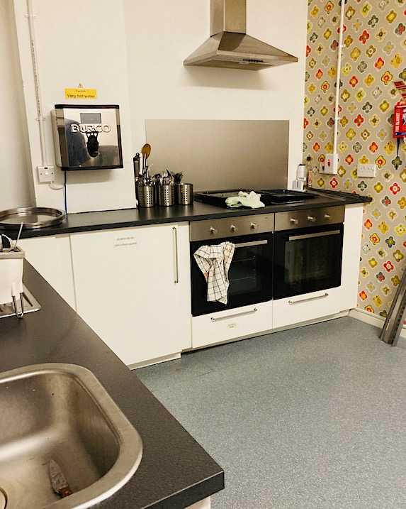 safe kitchen with pattered wall paper