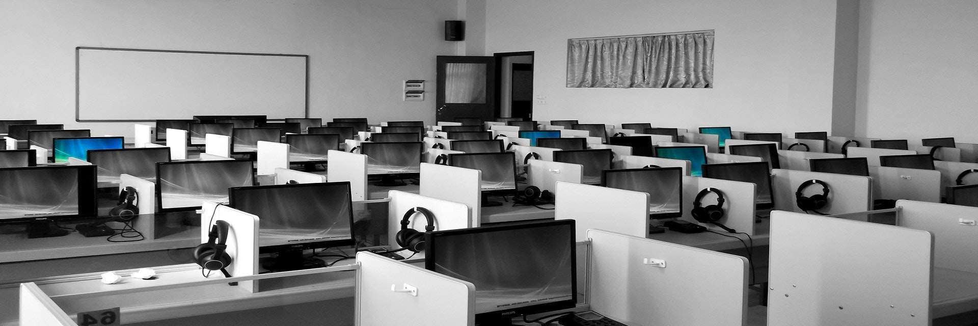 Image of an office with computers and desks - AnyPcFixed Ltd - Business I.T. Support & Maintenance, Data Networking, On-Site Support Callouts