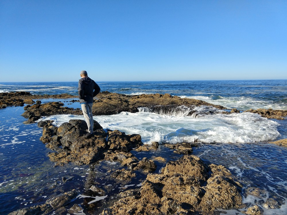 Chad looking into Thor's Well