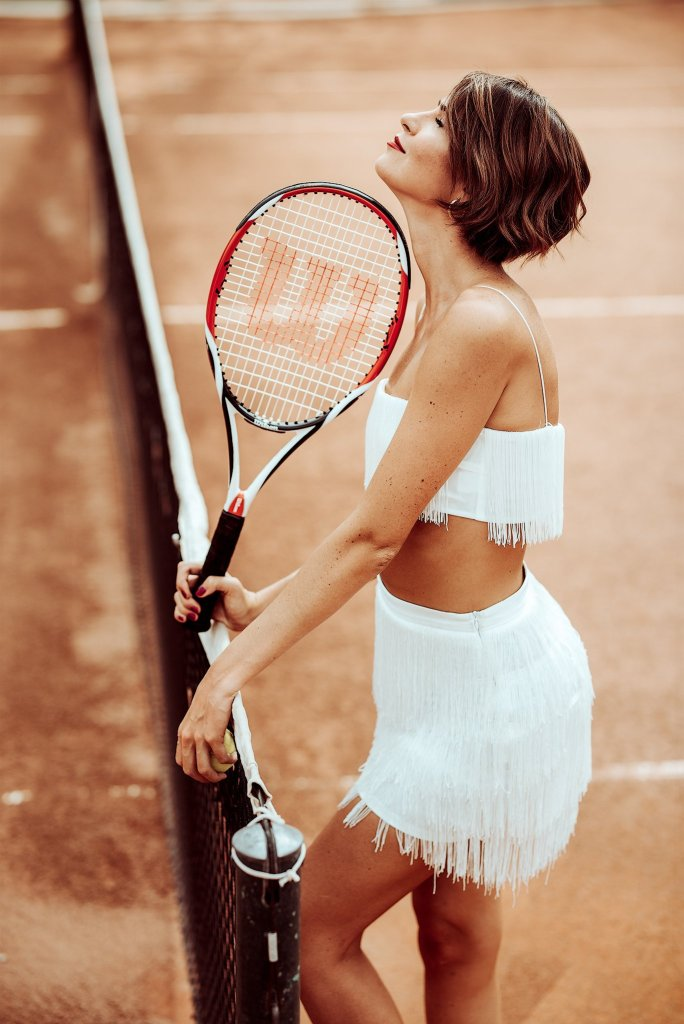 Fashion shoot in color of a girl tennis racket