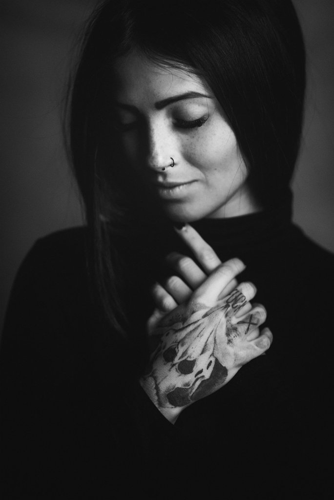 Emotional black and white portrait with tatoo and hands