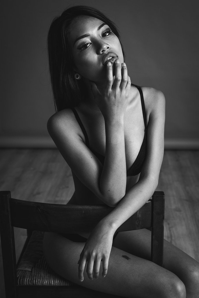 Glamour portrait in black and white in studio with chair