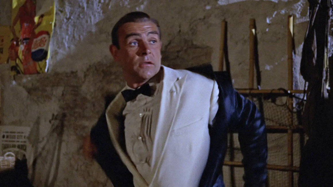 Connery in Goldfinger where James Bond unzips his wetsuit to reveal his black tie attire