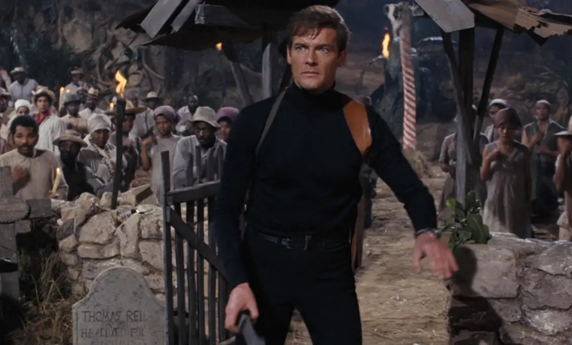 Roger Moore as James Bond wearing a Black Roll Neckin Live And Let Die