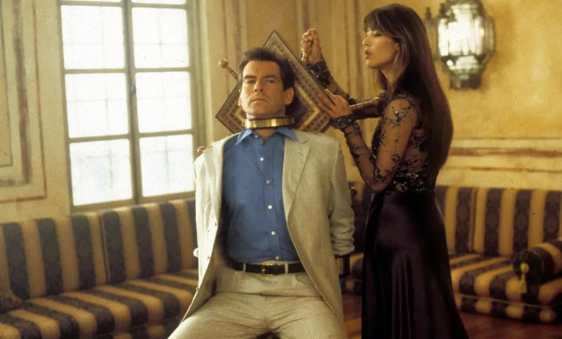 Pierce Brosnan as James Bond wearing a cream suit  in The World is Not Enough