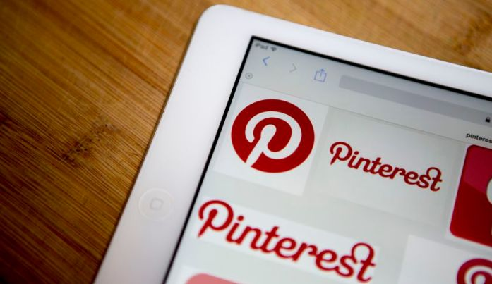 """alt=""""Pinterest Inc. logos are displayed for a photograph on an Apple Inc. iPad Air in Washington, D.C., U.S., on Thursday, Feb. 19, 2015. Pinterest Inc. the online scrapbooking company, is seeking to raise funding at a valuation of about $11 billion, according to a person familiar with the matter, continuing the soaring values of a group of high-profile technology startups"""""""