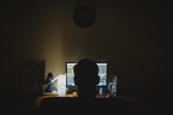 """Anonymous man in front of a computer."""
