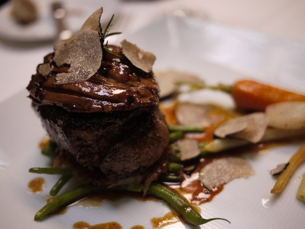 black truffles on plate with vegetables
