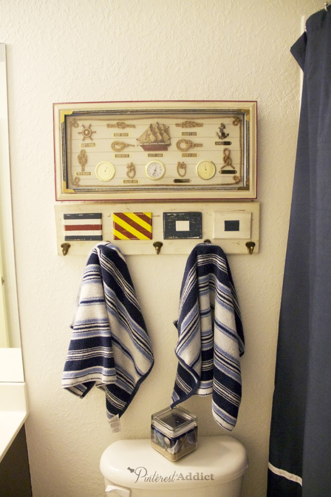 Nautical bathroom update. Hand towel hooks and nautical knots