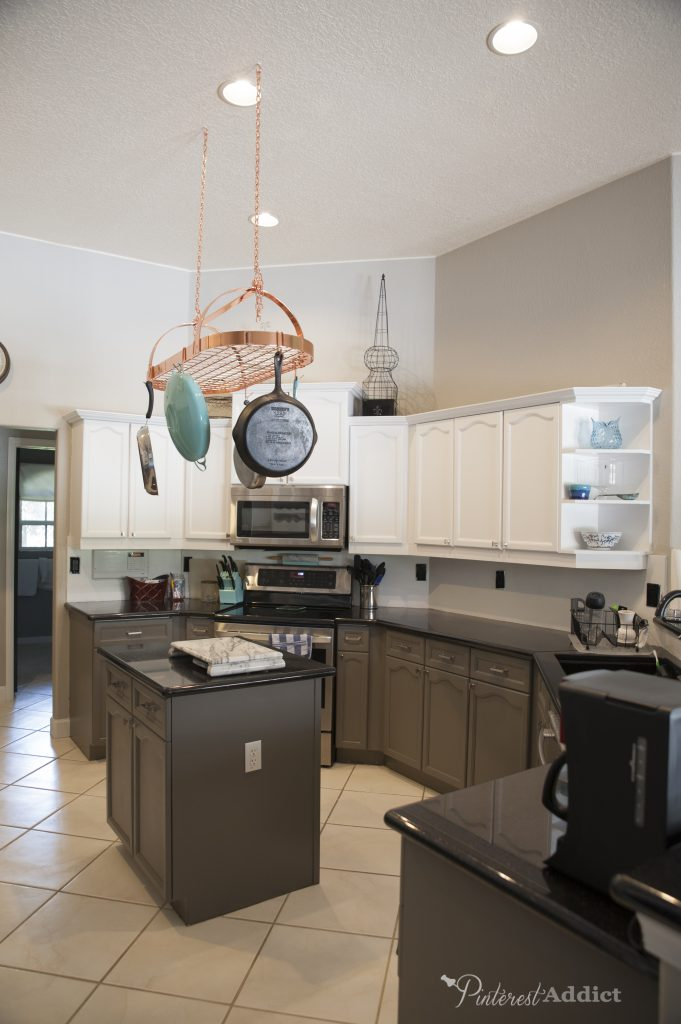 Sherwin Williams Snowbound on the top cabinets, Gauntlet Gray on the lower cabinets
