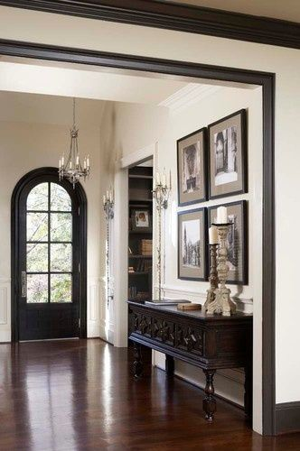 dark floors, white walls, black door