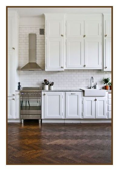 herringbone floors white kitchen