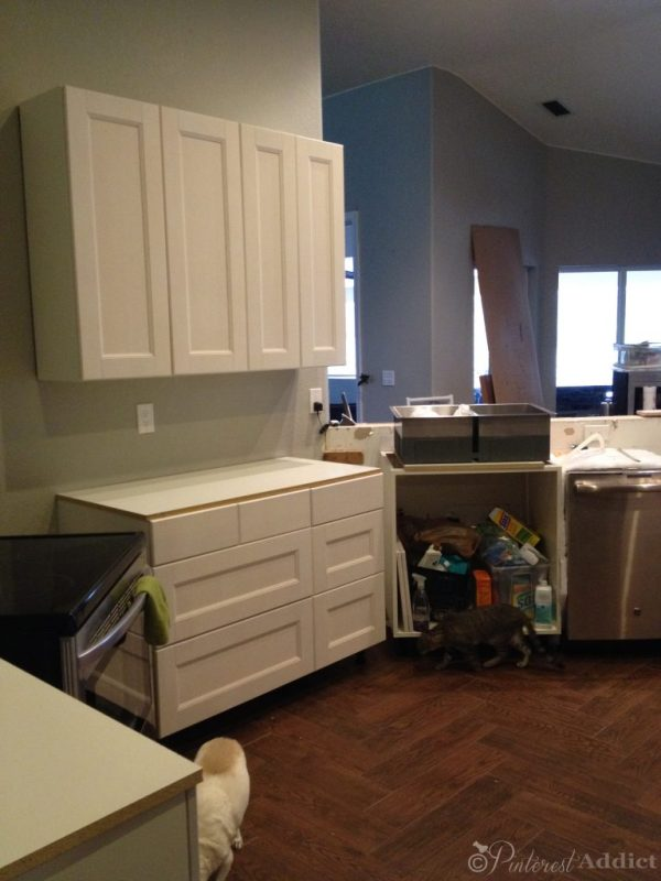 Cabinets installed but no sink - melamine counters